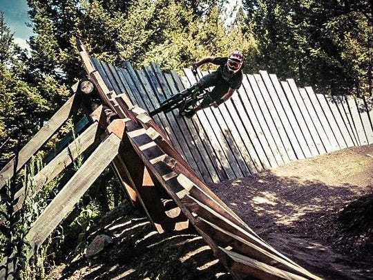 A mountain biker rides a trail at Discovery Ski Area's bike park. The ski area has five named mountain bike trails.