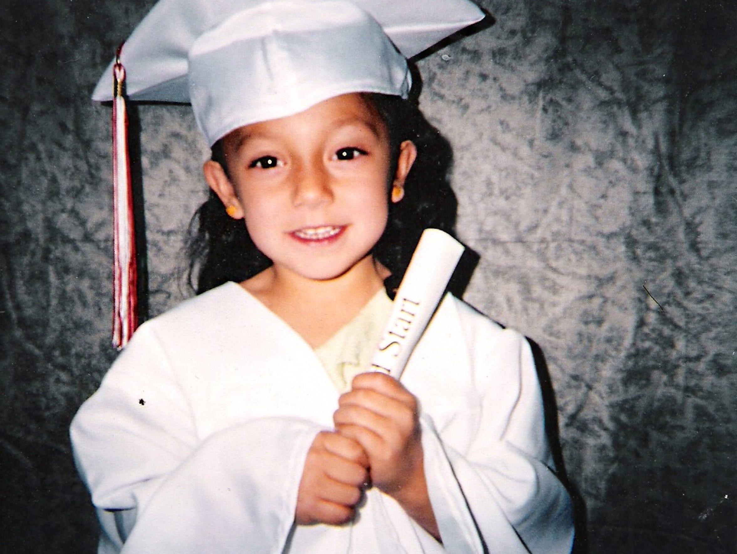 Jocelyn Najera's first graduation as a child