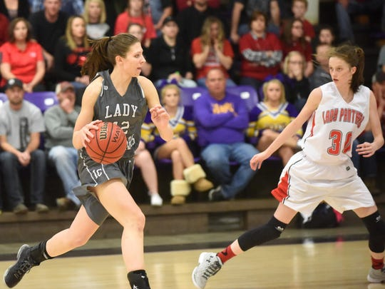 Izard County's Kennedy Cooper, left, is guarded by Norfork's Marleigh Dodson during the 1A Region 2 Tournament at Bay. Both Cooper and Dodson, as well as Calico Rock's Kelsey Fry, were named all-state recently. It was the second straight year for Cooper and Fry to be named all-state.