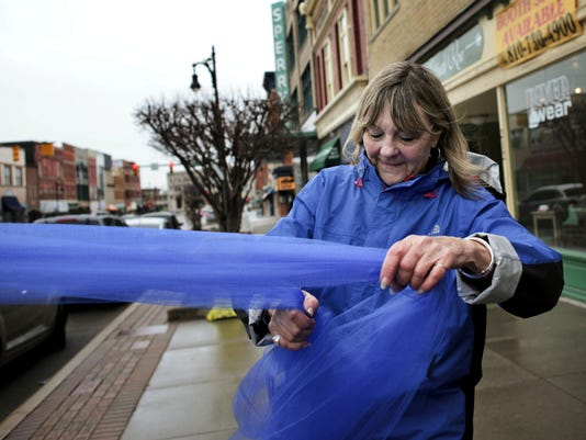 Blue ribbons promote ending child abuse