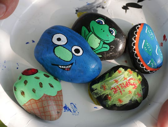 Painted rocks ready to be hidden Tuesday at Deland