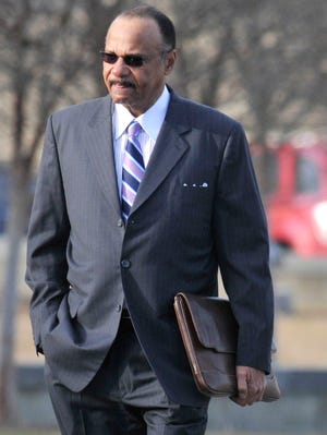John Knight, left, Alabama State University executive vice president, on his way to federal court Feb. 13, 2012 in Montgomery, Ala.