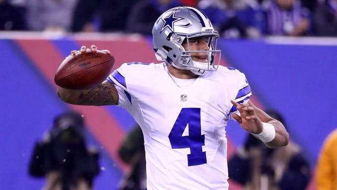 Dak Prescott of the Dallas Cowboys throws the ball against the New York Giants during the first quarter of the game at MetLife Stadium on Sunday.
