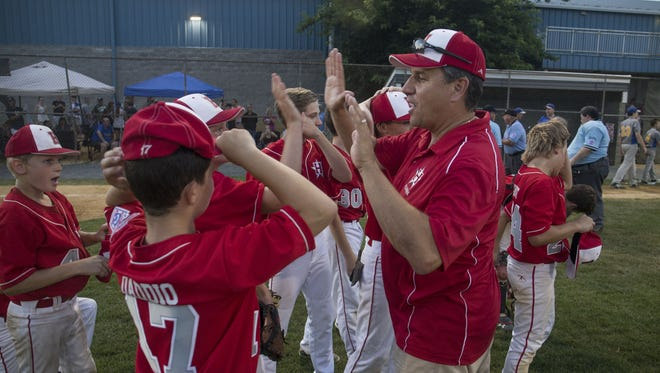 The Holbrook Little League All-Stars celebrate their District 18 championship in 2017. While the team was winning on the field, the league's financials were in disarray off of it.