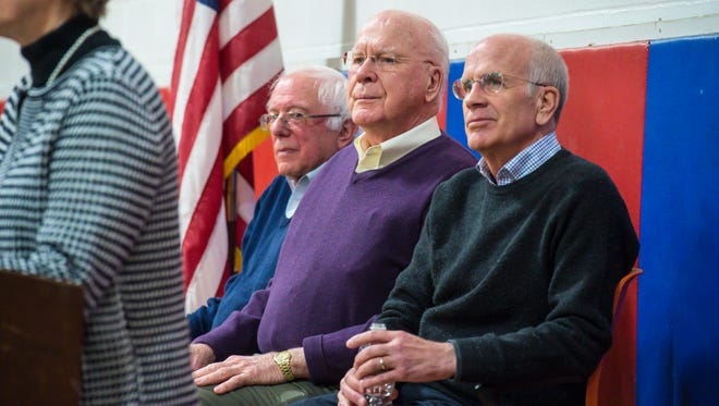 Vermont's congressional delegation, from left, U.S. Senators Bernie Sanders and Patrick Leahy, and U.S. Rep. Peter Welch are introduced by Vermont State Senator Jane Kitchel, D-Caledonia, left, at a town hall meeting at Hazen Union High School in Hardwick on Saturday, March 25, 2017.
