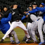 Chicago White Sox pitcher Jeff Samardzija, center, fights with Kansas City Royals players during the seventh inning of Thursday's game in Chicago. Samardzija was one of seven players to receive suspensions in wake of the brawl.