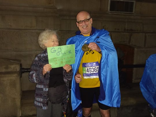 Oliver Mackson poses with his Mom after running the