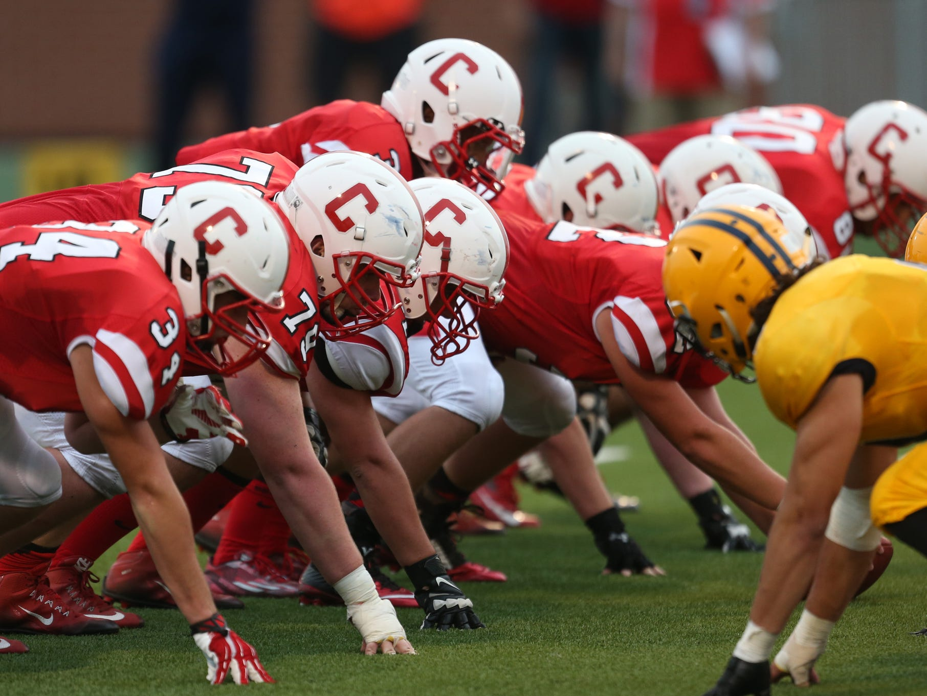 Canton lines up against Dearborn Fordson on Friday, Aug. 28, 2015, at Wayne State's Tom Adams Field in Detroit.