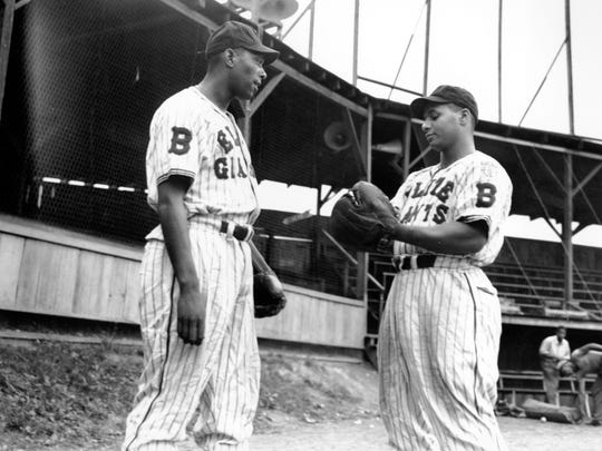 Sammy T. Hughes, left, and catcher Roy Campanella of