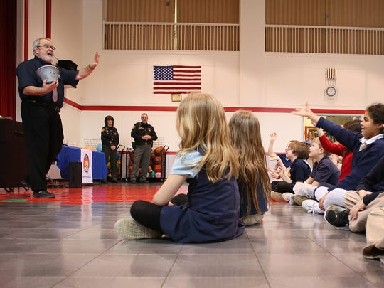 Students at Sacred Heart Elementary toss ways to show