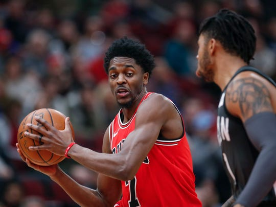 Apr 7, 2018; Chicago, IL, USA; Chicago Bulls guard Justin Holiday (7) drives to the basket against Brooklyn Nets guard D'Angelo Russell (1) during the second half at United Center. Mandatory Credit: Kamil Krzaczynski-USA TODAY Sports