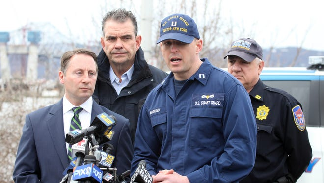 U.S. Coast Guard Lt. Mark Magrino, speaks to the media about the recovery operations after the fatal boat crash on the Hudson River, as Westchester County Executive Robert P. Astorino, left, and Public Safety Commissioner George Longworth look on March 13, 2016.