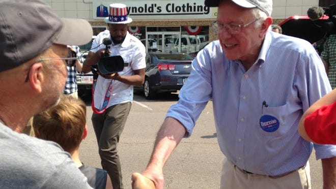 Vermont Sen. Bernie Sanders greets supporters upon arriving in downtown Denison.