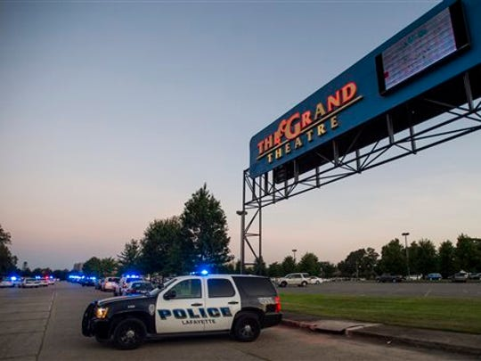 A Lafayette Police Department vehicle blocks an entrance at The Grand Theatre in Lafayette, La., following a shooting at the theater, Thursday, July 23, 2015.