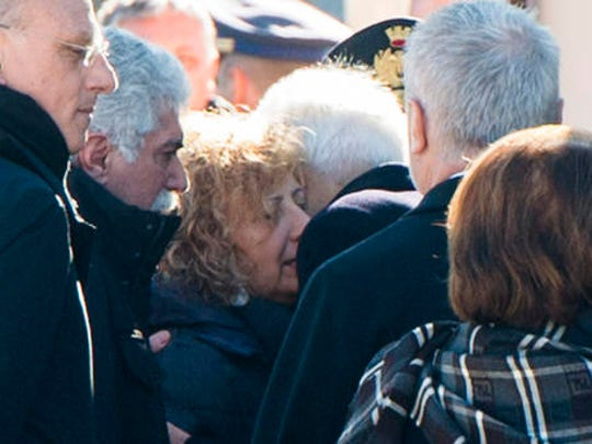 Giovanna Di Lorenzo, mother of Italian victim Fabrizia Di Lorenzo, is hugged by Italian President Sergio Mattarella upon her arrival from Berlin on a plane carrying the coffin of their daughter, at Rome's military airport of Ciampino, Saturday, Dec. 24, 2016. Di Lorenzo, 31, is among the 12 people who perished when a truck plowed through a Christmas market in Berlin last Monday.