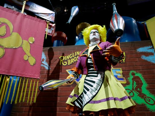 "A Ringling Bros. and Barnum & Bailey clown juggles for fans during a pre show for fans Saturday, Jan. 14, 2017, in Orlando, Fla. The Ringling Bros. and Barnum & Bailey Circus will end the ""The Greatest Show on Earth"" in May, following a 146-year run of performances. Kenneth Feld, the chairman and CEO of Feld Entertainment, which owns the circus, told The Associated Press, declining attendance combined with high operating costs are among the reasons for closing."