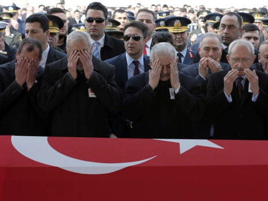 Turkey's political leaders, commanders and family members attend funeral prayers for Mahmut Uslu, one of five Turkish soldiers killed in an attack by IS militants around the Syrian town al Bab on Tuesday night, during a ceremony in Ankara, Turkey, Thursday, Feb. 9, 2017.