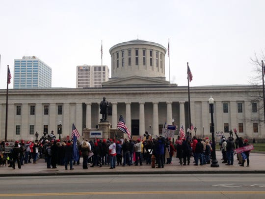 Supporters and opponents of president Donald Trump face off in front of the Ohio state house in Columbus, Ohio on Saturday, March 4, 2017.  The extraordinary clash of several hundred people in one of America's most closely-divided battleground states featured chanting and name-calling as well as opposing activists leaning in to try to hear each other out on the unconventional president.