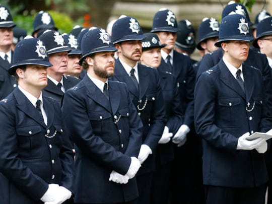 Police officers listen to the funeral service for PC Keith Palmer at the Southwark Cathedral in London, Monday, April 10, 2017. Unarmed PC Keith Palmer was stabbed to death by British attacker Khalid Masood who drove a rented SUV into pedestrians on Westminster bridge and then fatally stabbed the police officer outside Parliament on March 22.