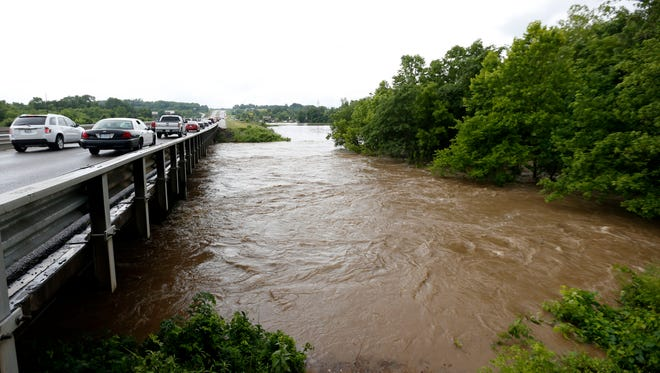 The James River overflows its banks as it passes under Campbell Avenue on Friday, June 19, 2015