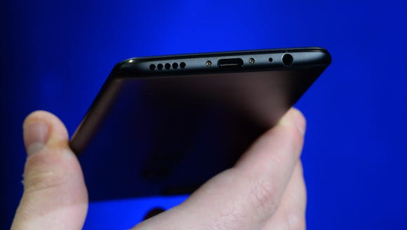 Yes, there is a regular headphone jack on the OnePlus