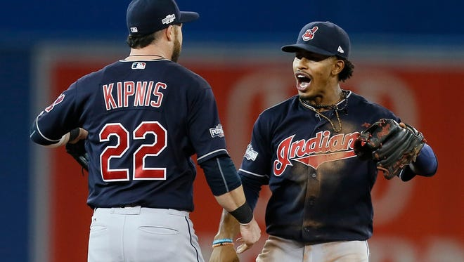 Cleveland Indians shortstop Francisco Lindor (right) celebrates with second baseman Jason Kipnis (22) after game three of the 2016 ALCS playoff baseball series against the Toronto Blue Jays at Rogers Centre. Mandatory Credit: John E. Sokolowski-USA TODAY Sports