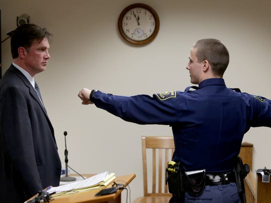 (L to R) Rick Steiger, lawyer for Larry Sevenski, 83, looks on as Michigan State Trooper Brock Artfitch talks and describes how he took down Sevenski during questioning  on Wednesday, April 12, 2017 in the courtroom of Judge Thomas J. Phillips the Antrim County courthouse in Bellaire, Michigan.