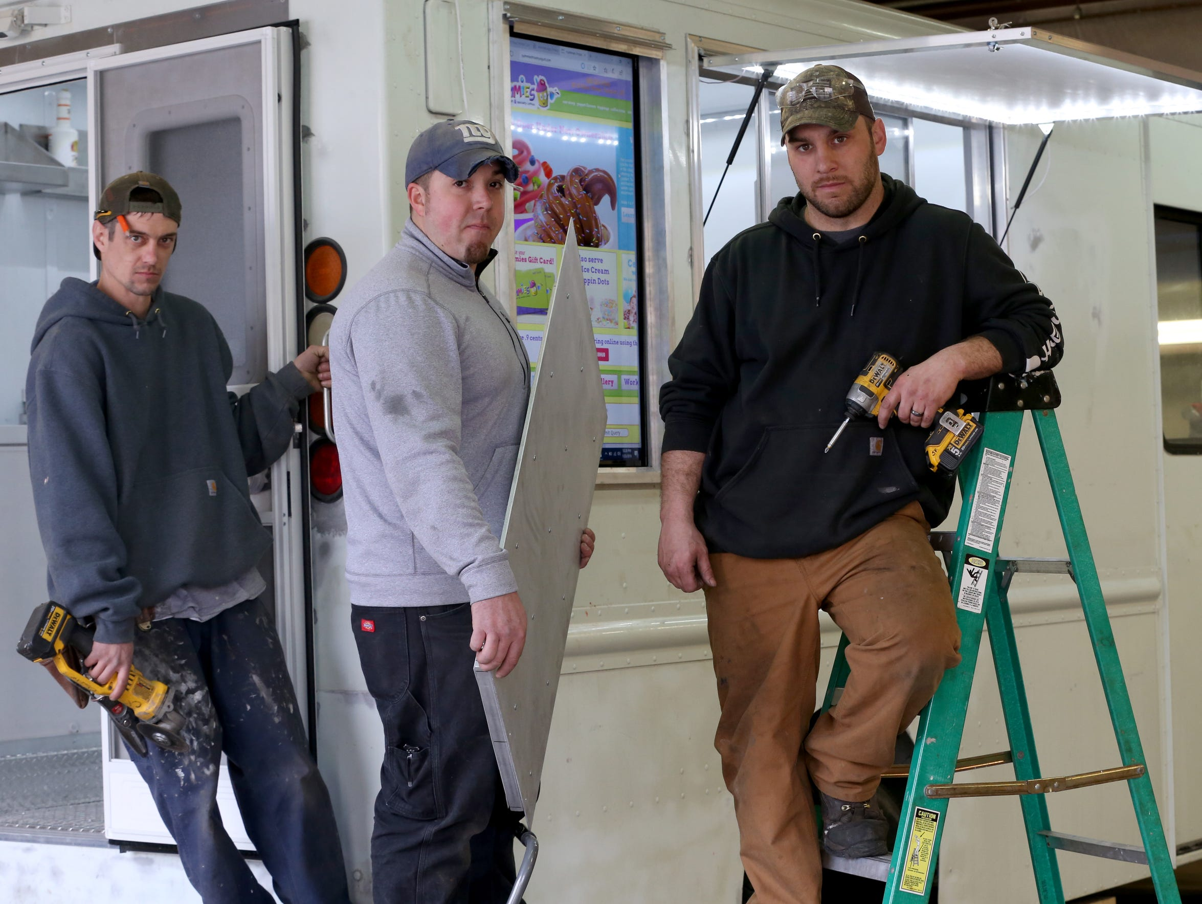 From left, Edward Knox, Josh Zwierlein and Charlie Lewis of Four Horse Customs. They are all former M Design employees.