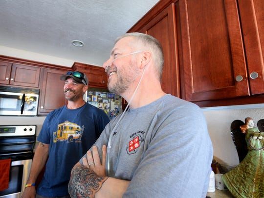 Jason Baker, right, a Great Falls firefighter, visits