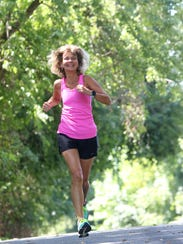 Diane Kukich runs along Hall Trail in Newark.
