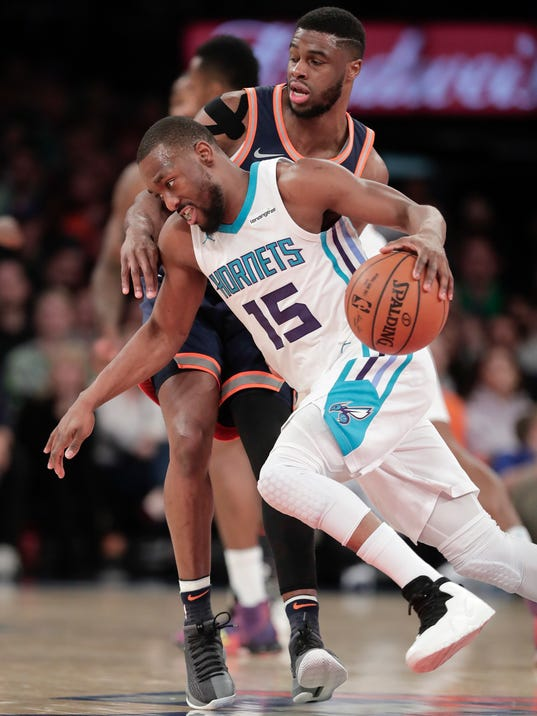 Charlotte Hornets guard Kemba Walker (15) drives against New York Knicks guard Emmanuel Mudiay (1) during the third quarter of an NBA basketball game, Saturday, March 17, 2018, in New York. (AP Photo/Julie Jacobson)