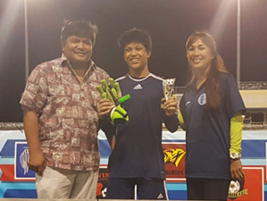 Wings FC's Marcus Del Rosario poses for a photo with