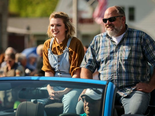 American Idol finalist Maddie Poppe is filmed for the show during a parade in her hometown of Clarksville, Iowa, with her father Trent Tuesday, May 15, 2018, before a concert at the Butler County Fairgrounds in Allison.
