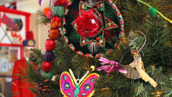 """Volunteers at the Deming-Luna-Mimbres Museum puts on their festive best during the Christmas holiday season. Christmas trees and decorated exhibits adorn each floor of the """"Smithsonian of the Southwest."""" located at 301 S. Silver Street."""