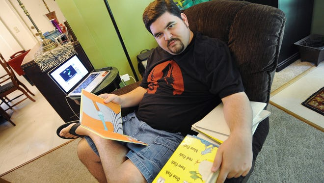Watson Dollar sifts through his collection of Dr. Seuss books. Diagnosed with autism at age 2, Watson has long had an affinity for Dr. Seuss books and has an extensive collection.