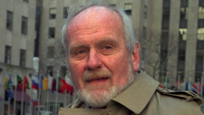 Donald Bain, a ghost writer of fiction and non-fiction, poses in New York's Rockefeller Center near the skating rink in Jan. 1997.