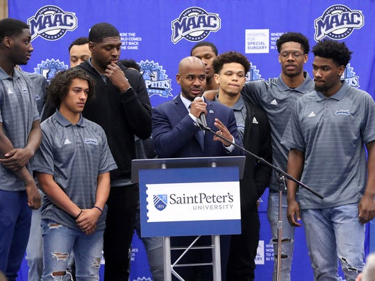 Shaheen Holloway is surrounded by players after he is introduced as the new basketball coach at a press conference at  St. Peter's University.  Thursday, April 12, 2018