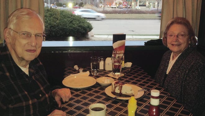 Jerry and Betty Flury, regular customers of Hogan's, are ready to share one of Mitch Albom's favorite desserts, Amaretto Almond Tofutti Pie. Albom was a regular customer and has written about his fond memories of the warm, welcoming ambiance.