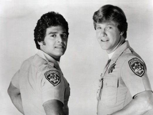 """Erik Estrada with co-star Larry Wilcox in a 1977 photo from """"ChiPs."""" Ed Harris appeared as a """"bad guy"""" in the popular series, Estrada recalls. Harris asked Estrada for advice on riding the motorcycle."""