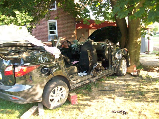 Police said emergency crews had to extricate two people from the wreckage of this Mazda van after a two-vehicle crash in Heidelberg Twp. on Saturday, Aug. 15, 2015.