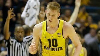 Marquette's Sam Hauser reacts after his three-point basket against St. John's during the second half Tuesday.