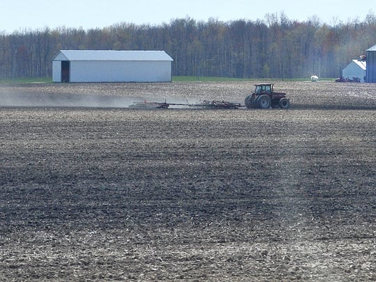 A farmer tends to his field in the Crawford County area. Agricultural producers across north central Ohio have been waiting for a week like this one ever since the 2015 growing season began about a month ago.