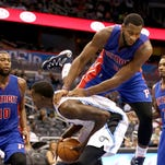 Detroit Pistons center Andre Drummond lands on top of Orlando Magic center Dewayne Dedmon, center bottom, in a preseason game in Orlando on Friday, Oct. 17, 2014.