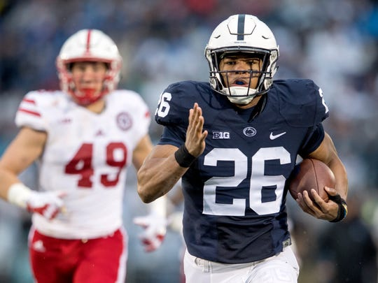 Penn State running back Saquon Barkley runs for a touchdown ahead of Nebraska defenders during an NCAA college football game Saturday, Nov. 18, 2017, in State College, Pa. (Abby Drey/Centre Daily Times via AP)