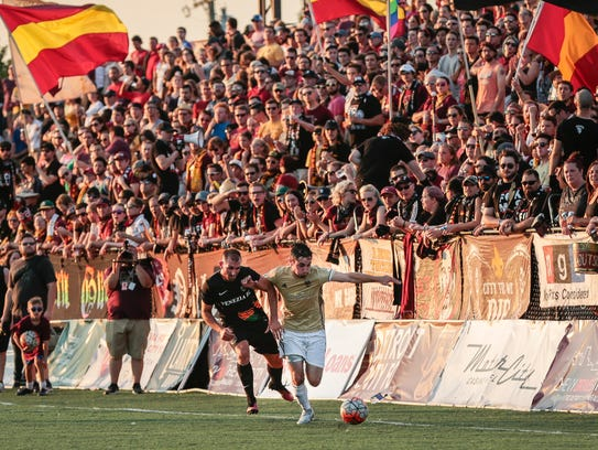 Detroit City FC's Zach Schewee, right, is defended