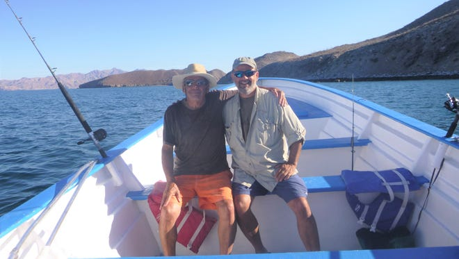 Frank Garza of Phoenix (left) and his son Keith, of Oregon, spent a memorable week in Baja California swimming with whale sharks.