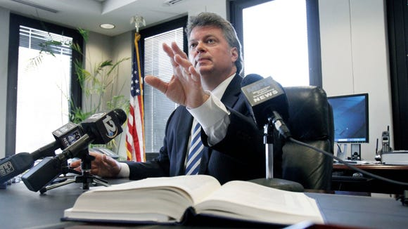 In this Feb. 7, 2012, file photo, Attorney General Jim Hood explains to reporters that he is upset the House Judiciary A Committee would not let him testify on a bill that would cut his authority. Under the bill, any state agency would be able to hire its own lawyer without Hood's approval.