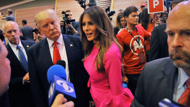 Donald Trump and his wife, Melania, talk with the media after the GOP debate in Miami on March 10, 2016.