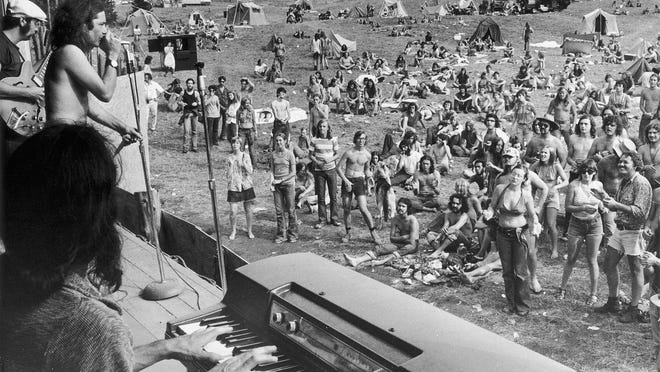 A band plays before concertgoers on Sept. 1, 1973, the opening day of a rock festival in Holland, Vt., that attracted thousands of young people over the three-day Labor Day weekend. An exhibit will showcase how the state became a hotbed for the counterculture as the influx of young people had a lasting influence on the state's politics, agriculture, food and offbeat culture.