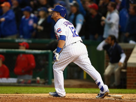 Chicago Cubs left fielder Kyle Schwarber (12) hits a solo home run in the seventh inning against St. Louis Cardinals in game four of the NLDS at Wrigley Field.
